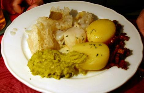 Lutfisk (on the left) with various accompaniments